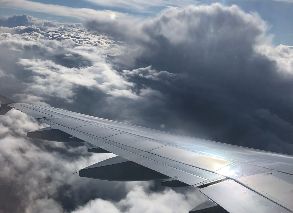 carbon offsets to compensate greenhouse emissions created by air travel
